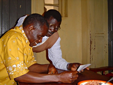 Pastor and Retired Pastor reading the Nyiha alphabet chart, August 2004