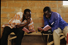 Chadian men reading