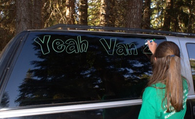 Decorating the vans in preparation...