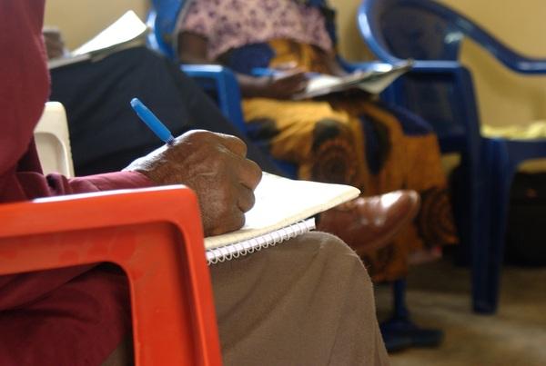 Man writing Kibende