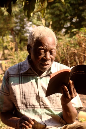 Baba reads from the Sukuma New Testament